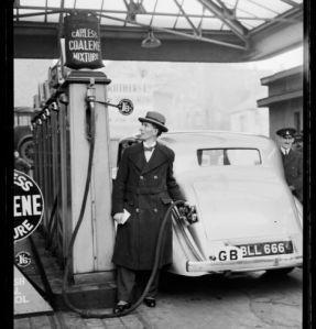 Filling a car with 'Coalene' petrol, 1935.
